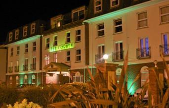 Exterior at night, Corbyn Apartments, Torquay, Devon