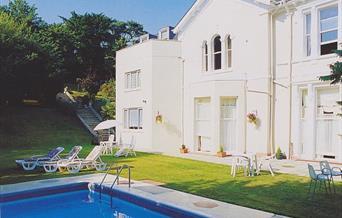 Swimming pool and exterior, Cranmere Court, Torquay, Devon