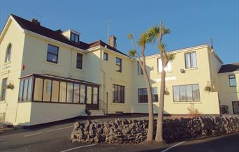 Front of house and car parking at the Millbrook, Torquay, Devon
