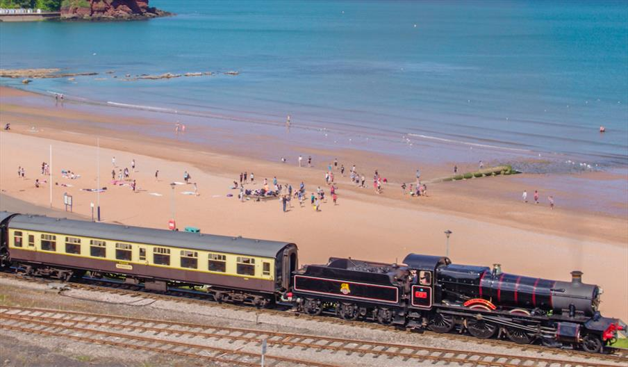 Steam train going past at Goodrington Sands in Paignton, Devon