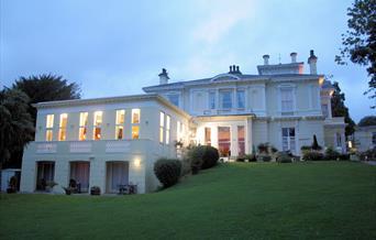 Howden Court Hotel at dusk, Torquay, Devon