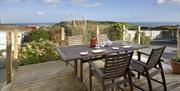 Dine out on the decking at Raddicombe Lodge, Brixham, Devon