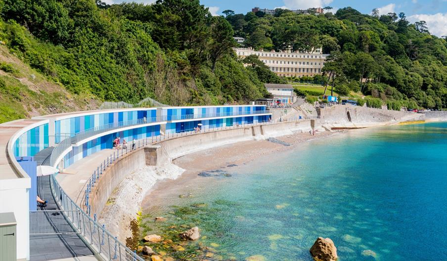 Blue beach huts at Meadfoot beach in Torquay, Devon