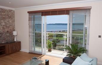 Lounge and view, The Penthouse, Goodrington Lodge, 23 Alta Vista Road, Paignton, Devon