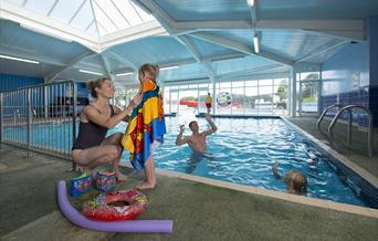 Fun in the indoor swimming pool at South Bay Holiday Park, Brixham, Devon