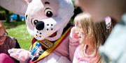 Fun with the mascots at South Bay Holiday Park, Brixham, Devon