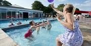 Fun in the outdoor swimming pool at South Bay Holiday Park, Brixham, Devon
