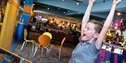 Fun at the arcades in The Carlton Hotel in Torquay, Devon