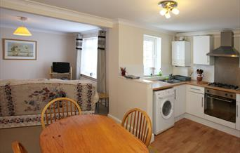Living space and kitchen area at Cedar Cottage, Torquay, Devon
