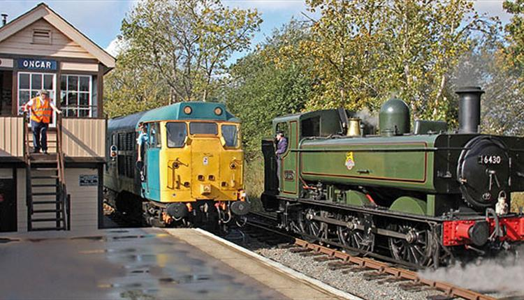 Steam and Diesel stop alongside Ongar Station signal box.