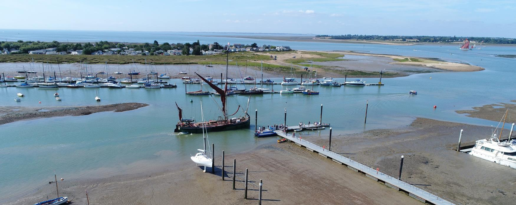 Brightlingsea town jetty with boats