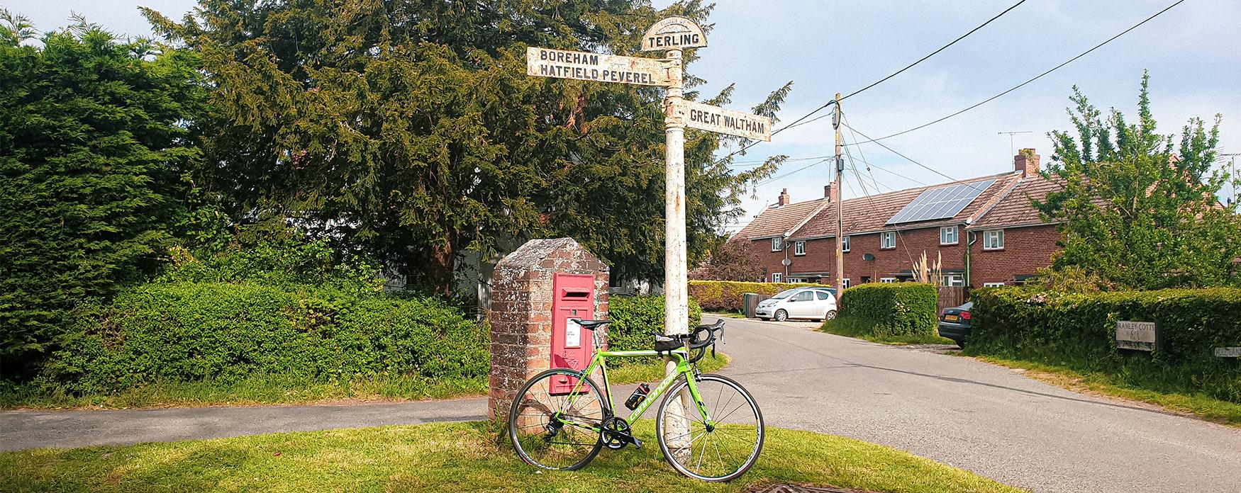 Bicycle propped up against a sign post