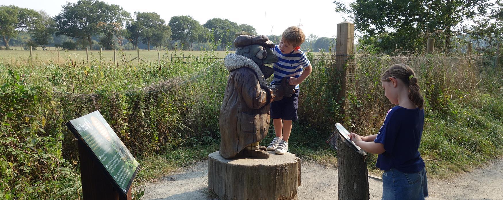 A family exploring Hanningfield Reservoir