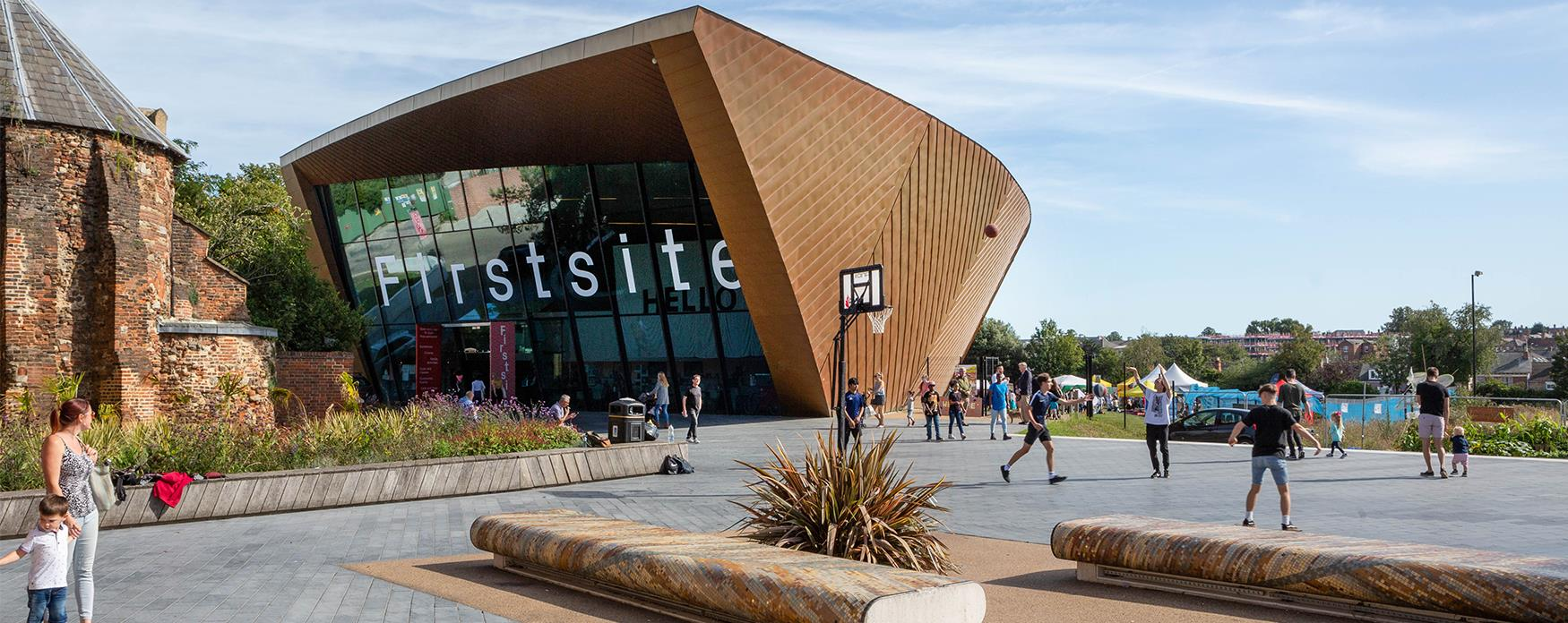 An exterior shot of Firstsite gallery with people in the foreground