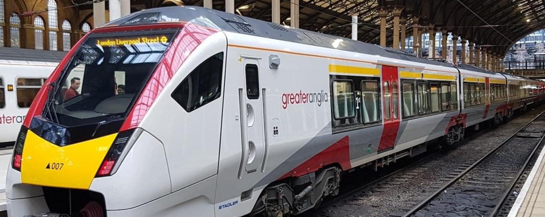 A Greater Anglia train stopped at a platform.
