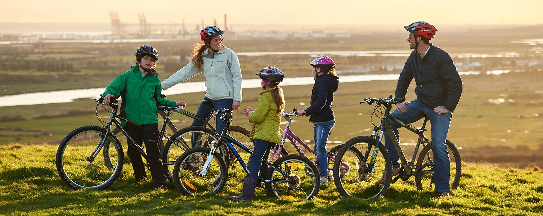 A family cycling at Hadleigh Country Park