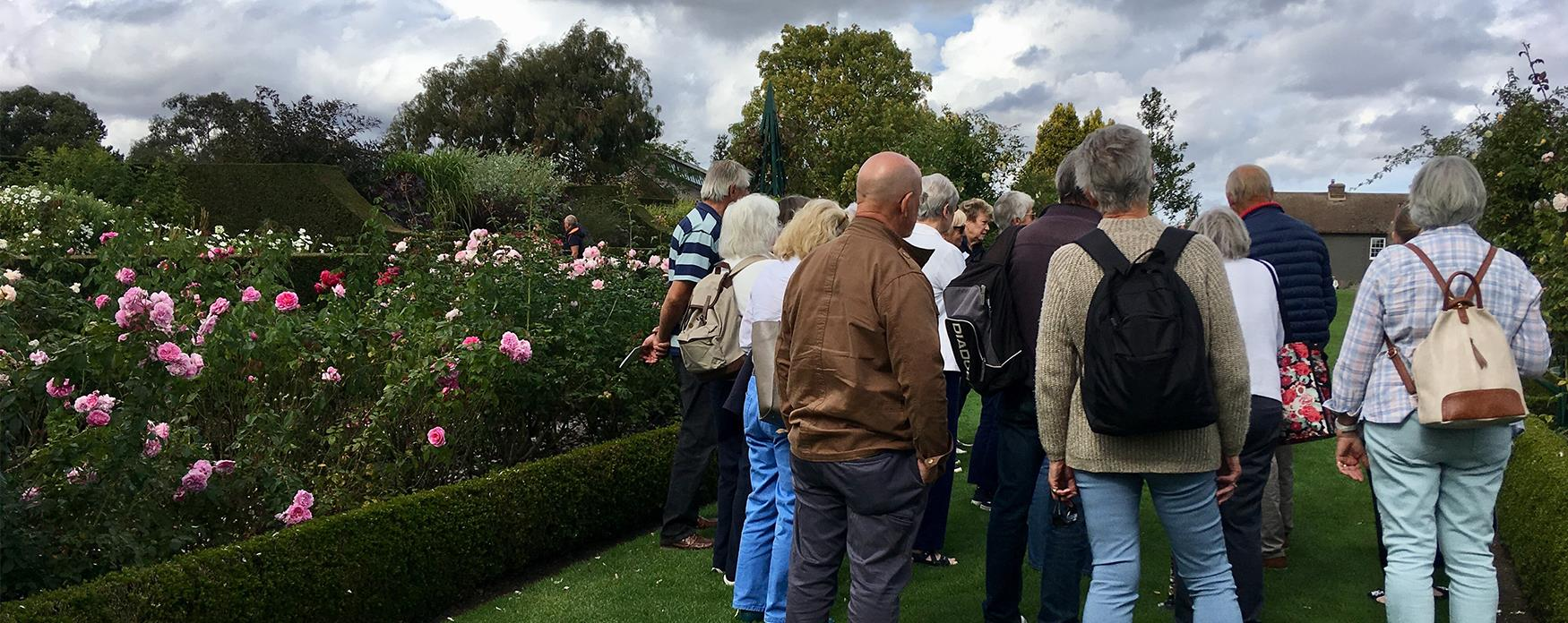 A group admiring the gardens at RHS Hyde Hall