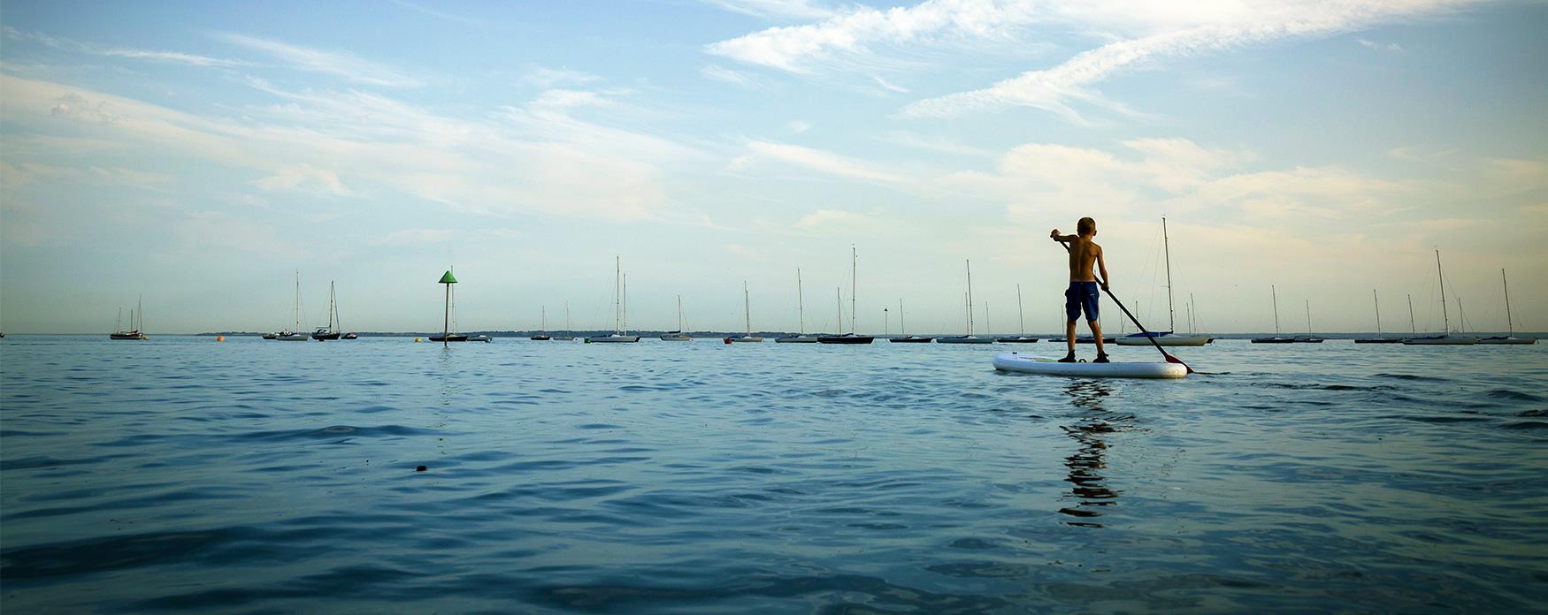Family Adventure Boy Paddleboarding