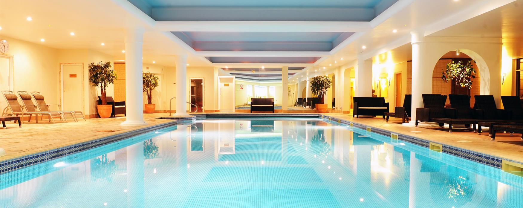 A swimming pool surrounded by loungers