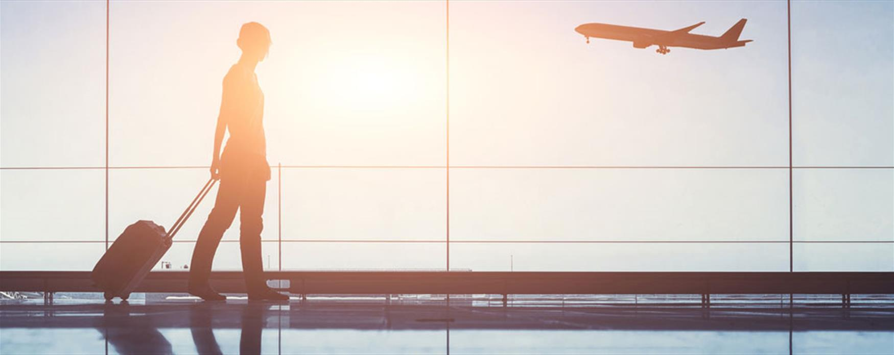 Airport terminal people traveling, silhouette of woman passenger with baggage in airport