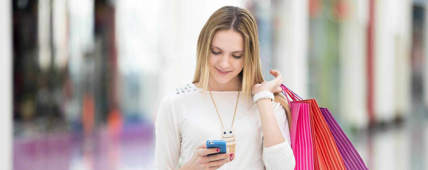Smiley Girl on phone shopping