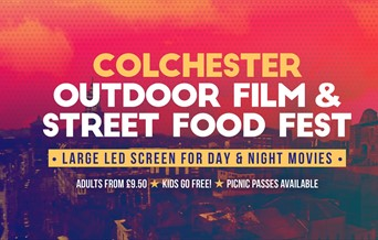 Colchester Outdoor film and street food fest, white writing on a red tinted photograph of castle park