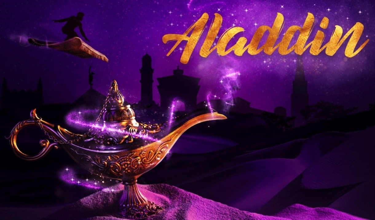 Aladdin rides his magic carpet in the distance, behind a magic lamp