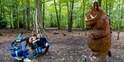 A small boy and his parents on the Gruffalo Trail