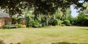 Spacious garden for photographs capturing memories of your special day