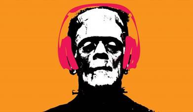 Frankenstein wearing headphones