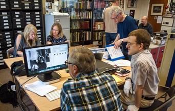 Volunteers scanning and digitising photos of jazz musicians