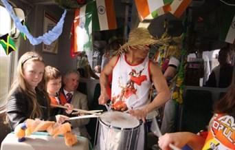 Drummer on train