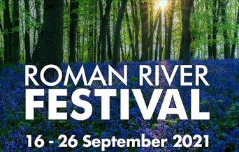 The Roman River Festival logo imposed on a picture of the sun breaking through the trees in a woodland full of bluebells. 16 - 26 September 2021.