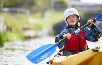 smiling girl in yellow kayak