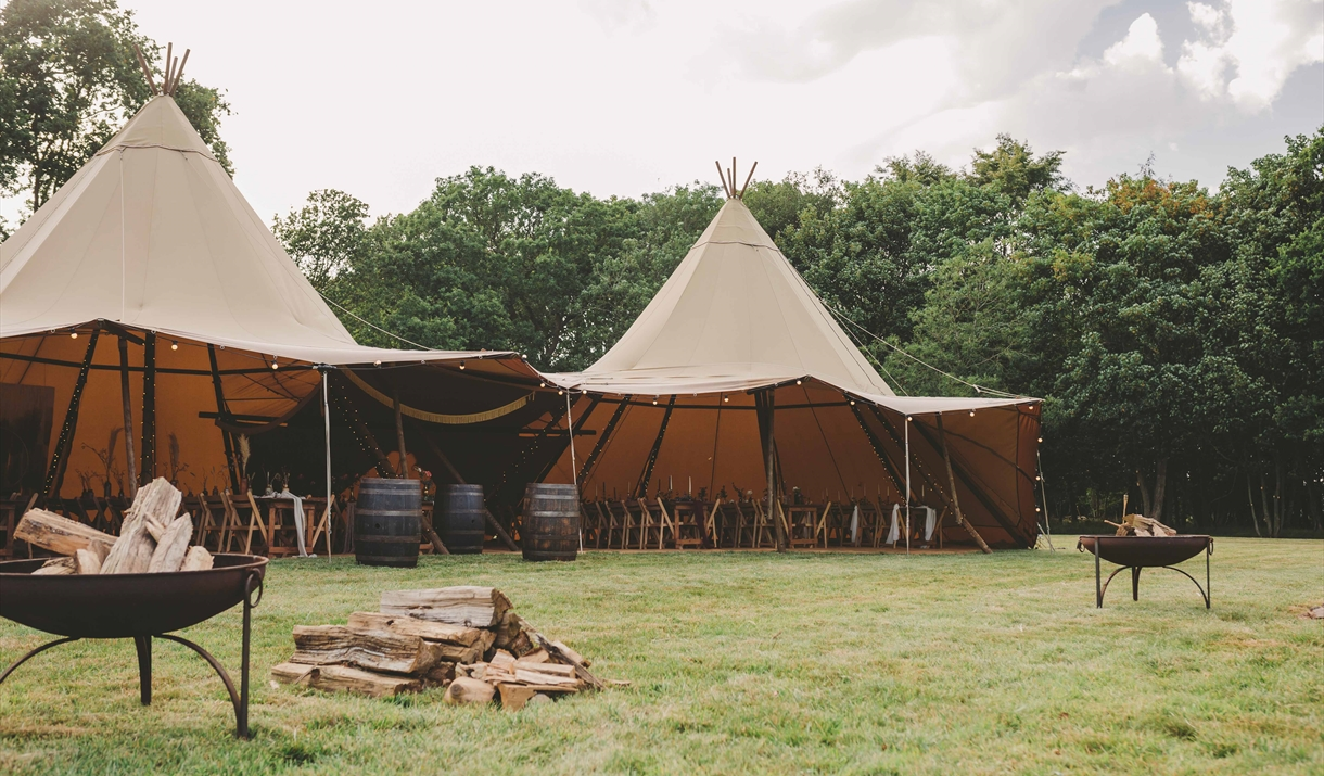 Tipi in secluded meadow