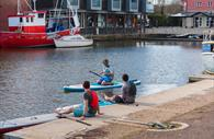 People sat beside the River Exe