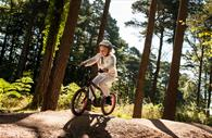 Child cycling in the forest