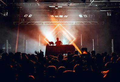 DJ performing in front of a crowd in a club