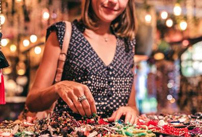 Woman browsing handmade crafts