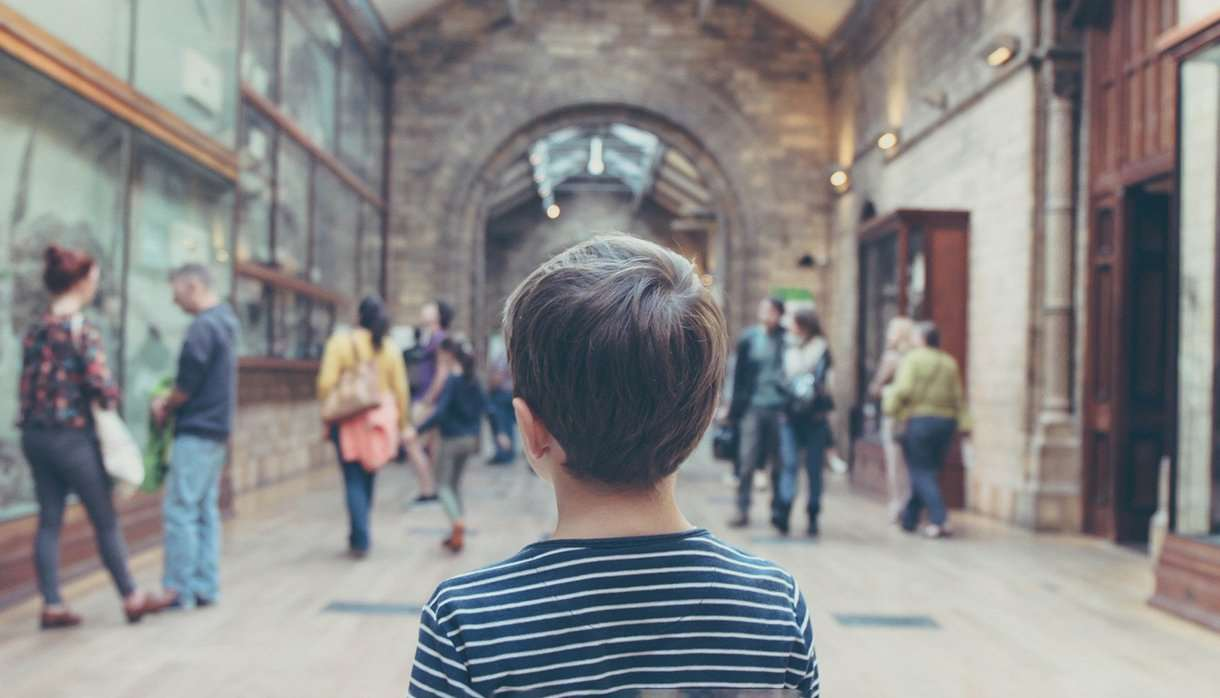 Child looking around a museum