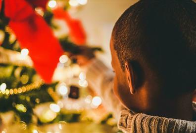 Small child close to Christmas tree