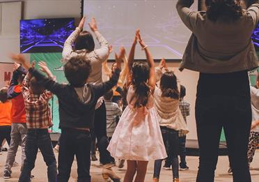 Kids participating in a theatre workshop