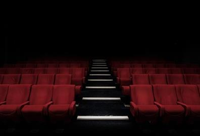 Empty red seats in a theatre