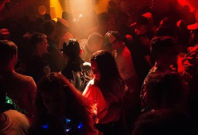 People dancing in a crowded club