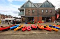 Kayaks & canoes outside the store