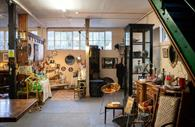 Room filled with antiques and collectables, furniture