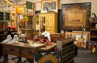 Room filled with antiques and collectables - art and furniture