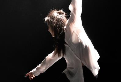 Person in casual wear dancing onstage