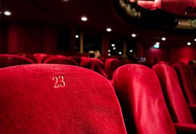 Red numbered seats at a theatre