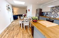 Open plan kitchen, dining area and living space